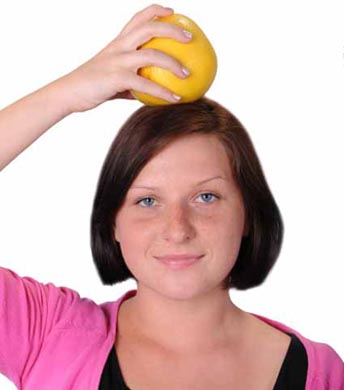 Girl Balancing Fruit on Head